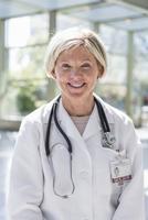 Caucasian doctor smiling indoors