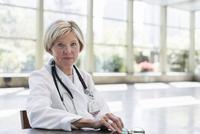 Caucasian doctor sitting in empty office