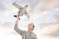 Caucasian boy flying toy airplane