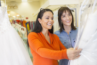Hispanic women shopping in bridal store