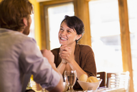 Caucasian couple talking in restaurant