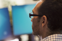 Hispanic businessman using computer in office