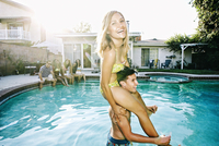 Couple playing in swimming pool