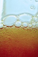 Close up of bubbles in beer glass