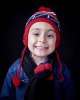Close up of Hispanic boy wearing warm clothing 11018073937| 写真素材・ストックフォト・画像・イラスト素材|アマナイメージズ