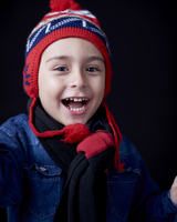 Close up of Hispanic boy wearing warm clothing