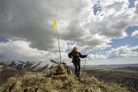 Caucasian woman standing on remote hilltop