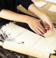 Baker cutting pie dough