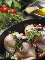 Close up of chicken breast wrapped with herbs