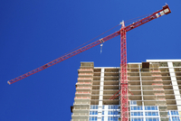 Low angle view of crane building highrise