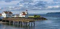 Dock and buildings on scenic coastline