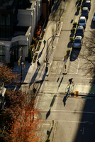 High angle view of bicyclist in city intersection