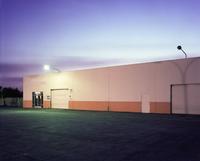 Floodlights over industrial garage doors