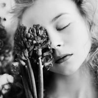 Caucasian teenage girl holding flower