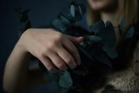 Caucasian teenage girl holding plants