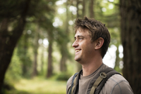 Caucasian man smiling in forest