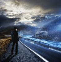 Businessman looking at highway 11018074495| 写真素材・ストックフォト・画像・イラスト素材|アマナイメージズ