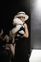 Elegant Caucasian woman with dog at fashion show 11018078744| 写真素材・ストックフォト・画像・イラスト素材|アマナイメージズ