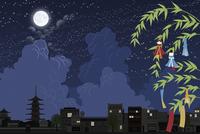 七夕の笹飾りと夜の街並み イラスト