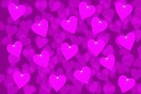 重なり合うピンク色のハートと光 CG