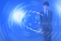 光る渦とビジネスマン CG