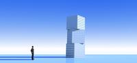 積まれた立方体を見上げるビジネスマン CG