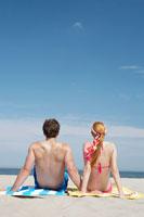 couple looking at view, at beach