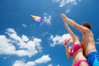 Young couple flying kite