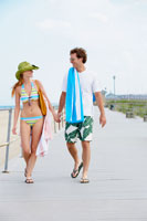 couple attire walking and holding hands