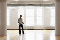 Female architect in empty room