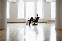 Man sitting at desk in empty office
