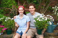 Young couple in garden (portrait)