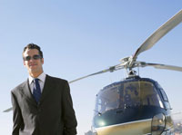 Businessman standing near helicopter