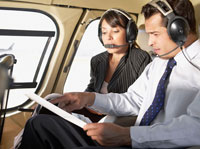businesspeople talking in helicopter