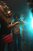 Clubbers using cell phone at nightclub