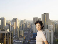 Young woman, city in background