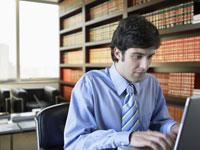 Businessman working on laptop 11021000741| 写真素材・ストックフォト・画像・イラスト素材|アマナイメージズ