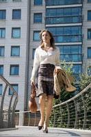 Businesswoman walking on bridge