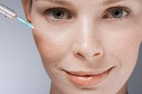 Syringe near womans face