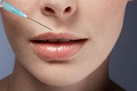 Syringe near womans lips
