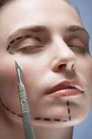 Scalpel by womans face with lines