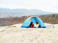 Couple in tent at rock strata