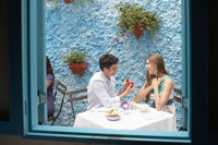 Man proposing woman in restaurant