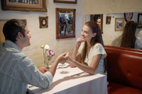 Young couple holding hands in restaurant