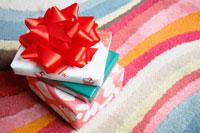 Three Christmas presents on rug
