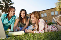 Three female students studying in park