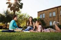 Three female students studying near