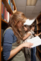 Three female students in library