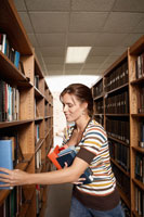 student taking books from bookcase