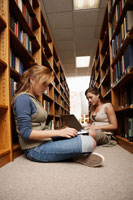 students studying on library floor